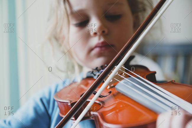 Close up of girl playing violin