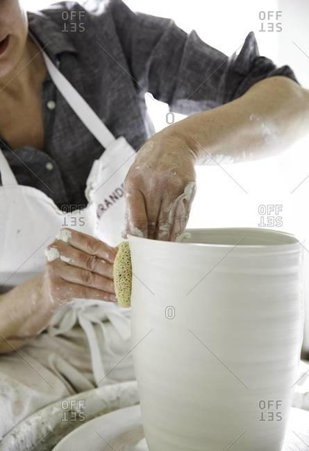 Ceramic artist in studio