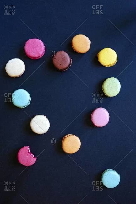 Colorful French macaroons arranged into heart-shape