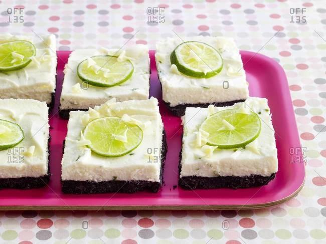 Key lime bars on magenta tray
