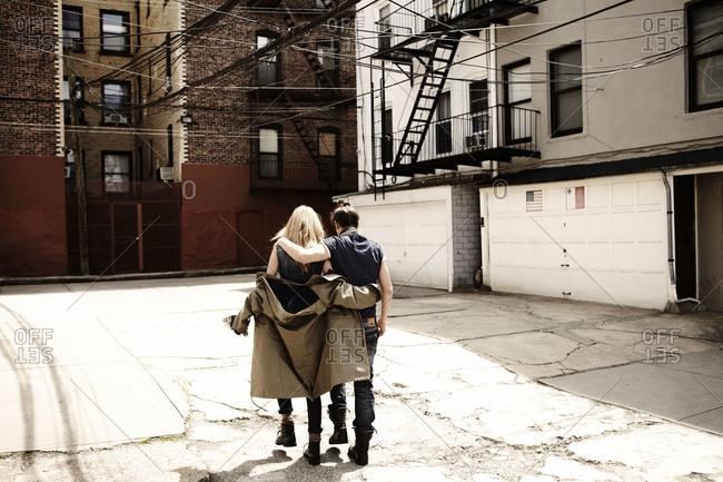 Couple walking in an urban neighborhood