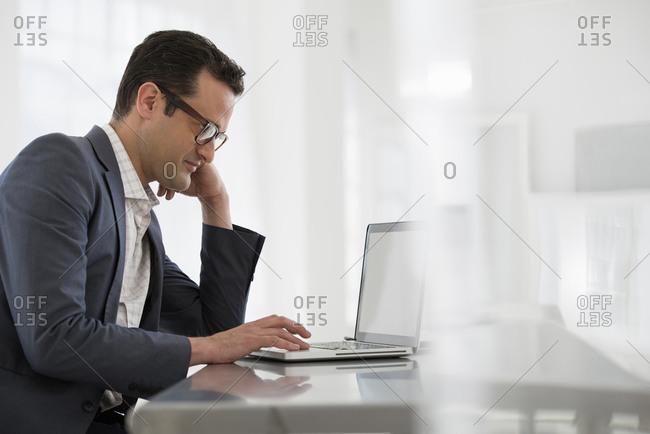 Businessman using a laptop computer.
