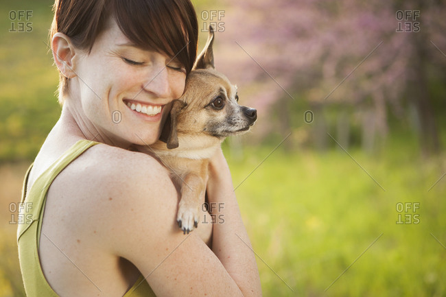Woman hugging her Chihuahua