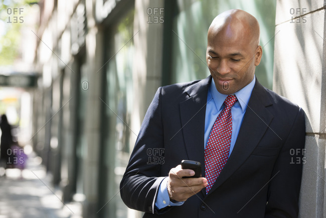 Businessman checking his phone