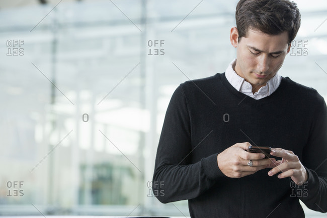 A young man checking his smart phone.