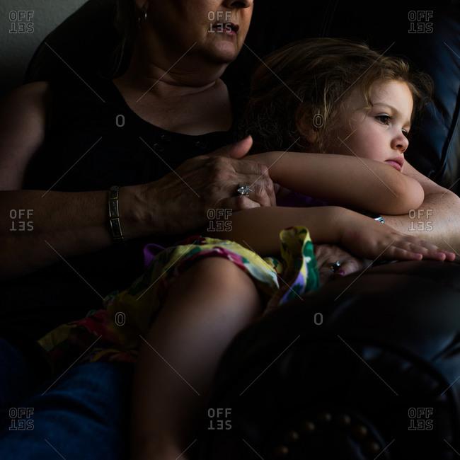 Elderly woman holding granddaughter
