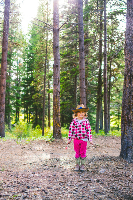 Girl in forest wearing cowboy hat