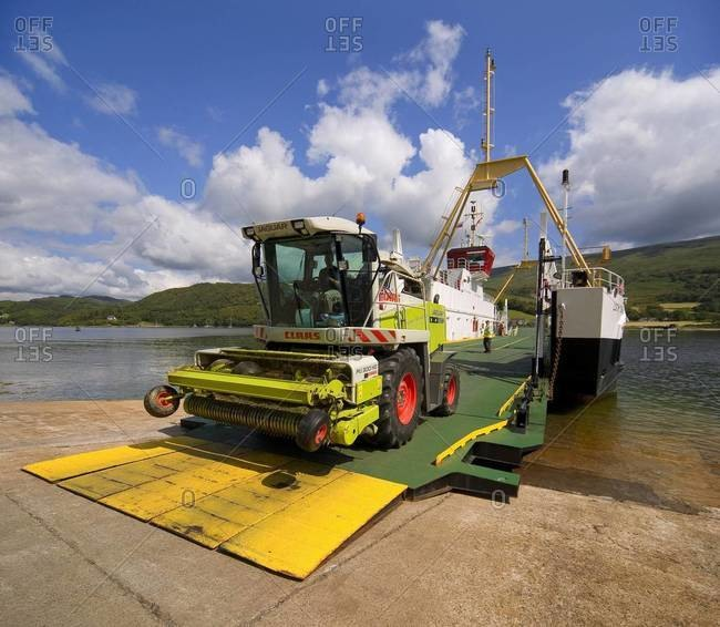 Agriculture machinery drives off the Colintrive ferry on the Isle of Bute