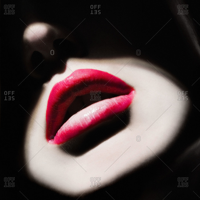 Close up of woman's lips in light