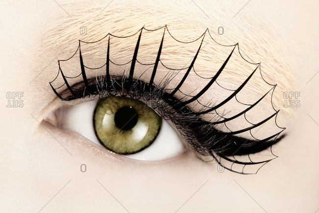 Close up of woman's eye with eyelash design