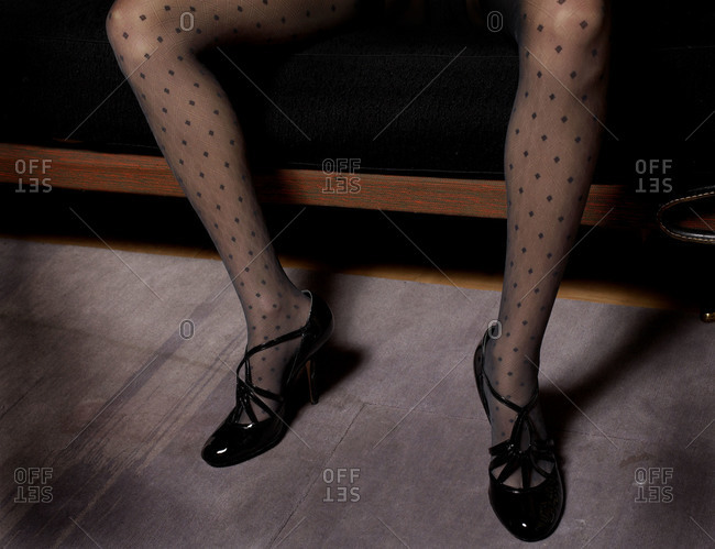 Legs of woman in spotted tights