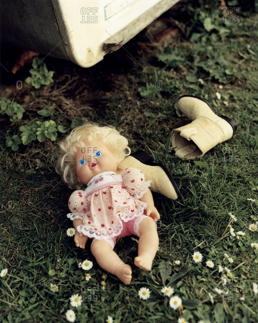 Doll left on grass