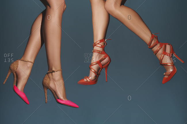 Legs of women in high-heeled shoes