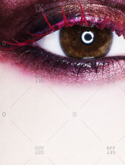 Close up of woman's eye in red colors