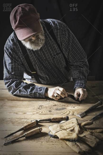 A man working in a reclaimed lumber yard workshop