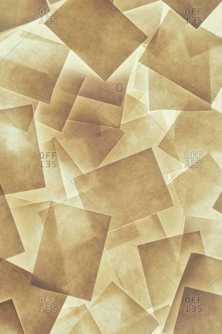 Post it notes arranged and overlapping, above a light source