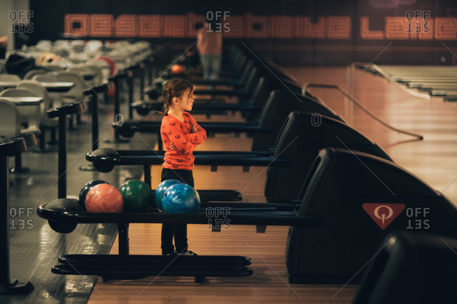 Young girl at the bowling alley