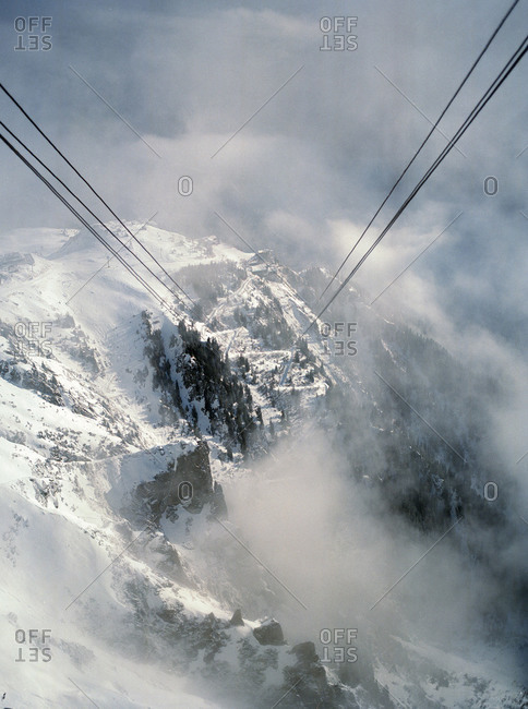Snow-covered mountains shrouded in fog