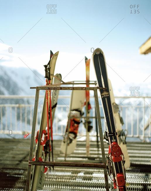 Skis and ski poles on a rack