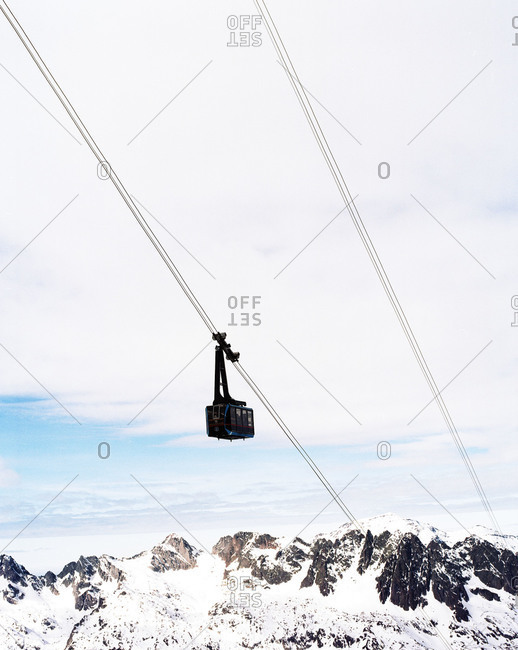 Ski lift over snow-covered mountains
