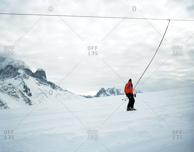 Skier being pulled by a cable