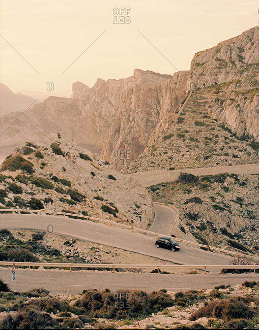 Car driving on a highway among mountains