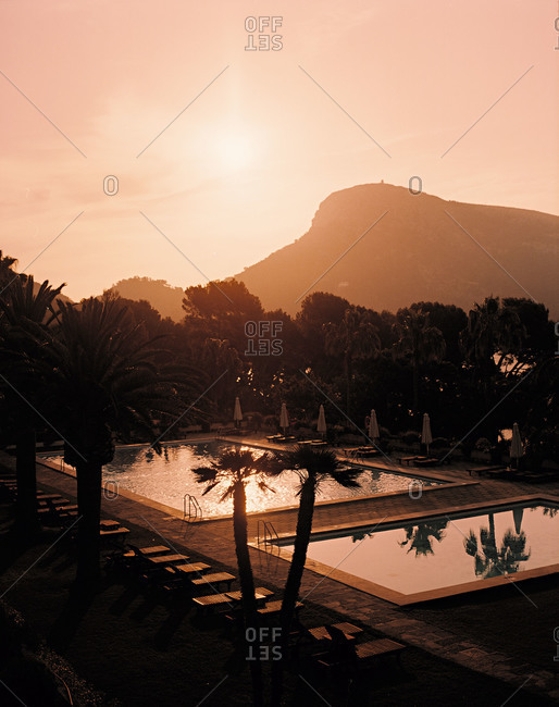 Sunset over swimming pools at a resort