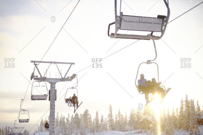 People riding the chairlift
