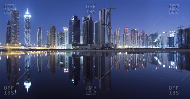 Dubai Business Bay skyline illuminated at night