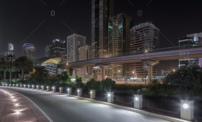 Dubai cityscape with metrostation at night