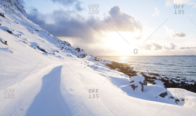 Snowy beach with sunset at Norway lofoten