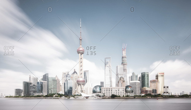 Modern skyline of Shanghai with moving clouds