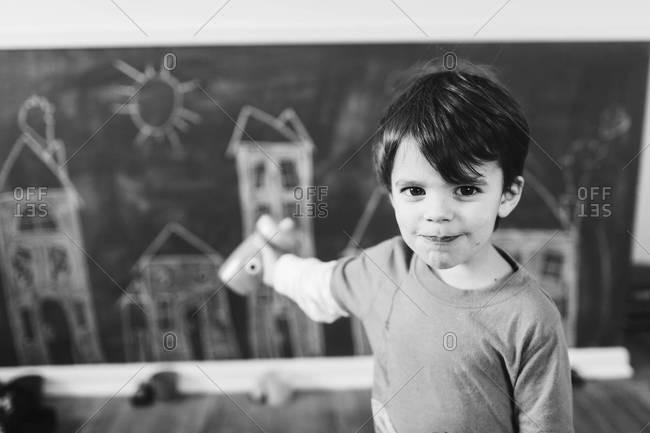 Boy points to chalk art