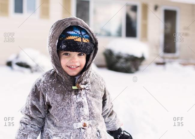 Boy covered in snow