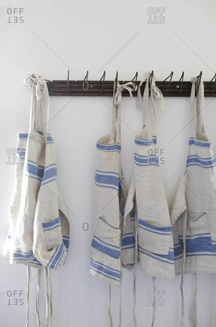 View of kitchen aprons on hooks