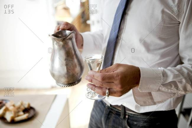 Man holding silver pitcher