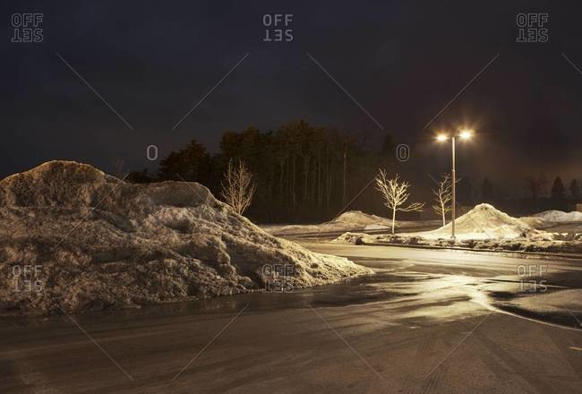 Snow covered parking lot at night