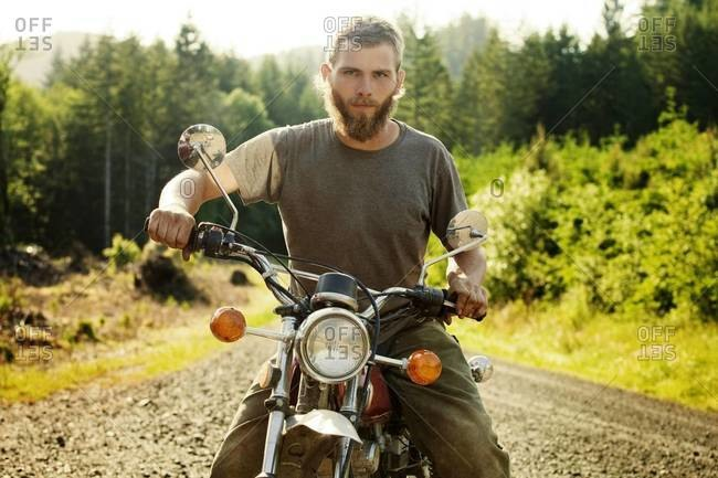 Portrait of young man on motorcycle