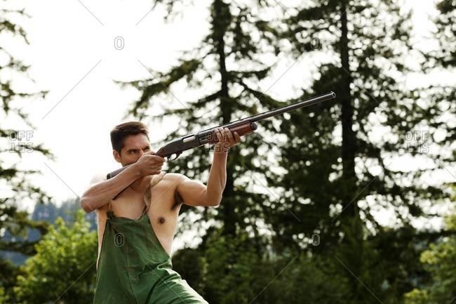 Hunter aiming gun