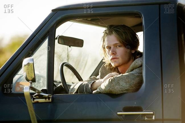 Portrait of young man in pick-up truck