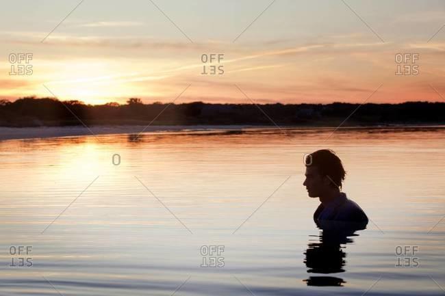Businessman standing in neck deep waters
