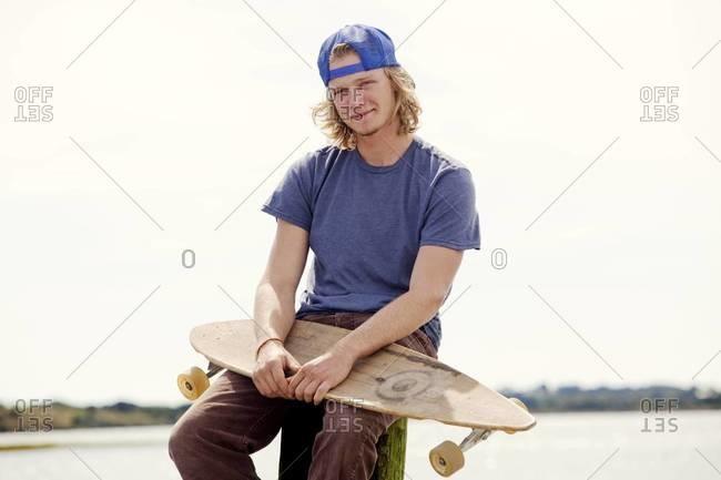 Portrait of skateboarder smiling