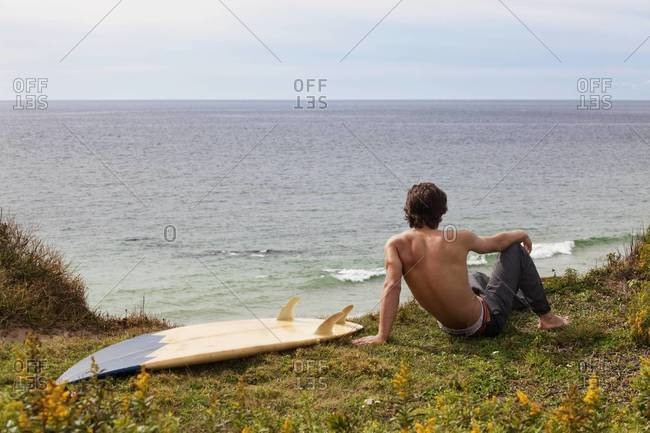 Surfer waiting for waves