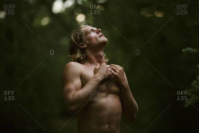 Shirtless young man in ecstasy