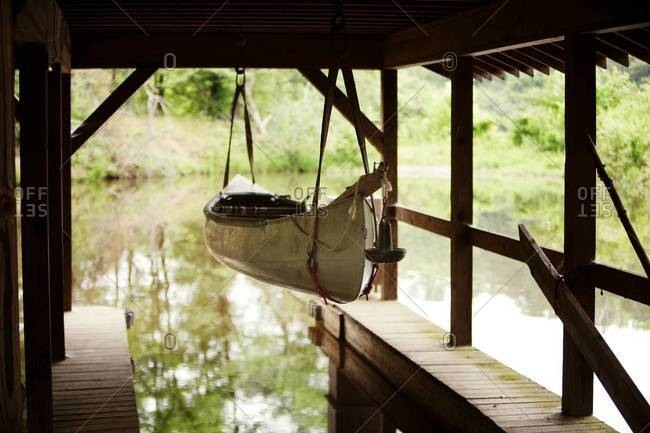Canoe hanging in boat house