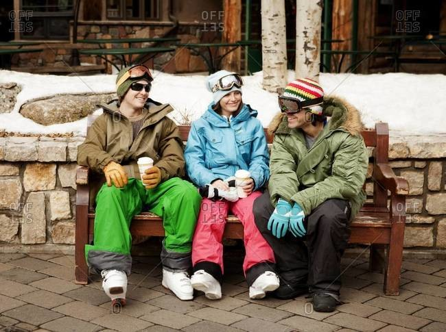 Three friends taking a break from skiing