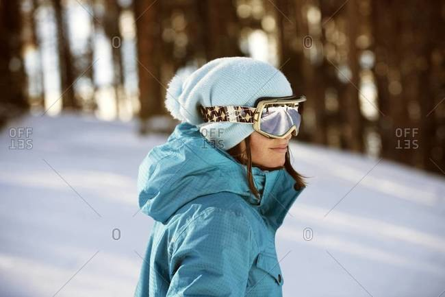 Portrait of woman standing on ski slope
