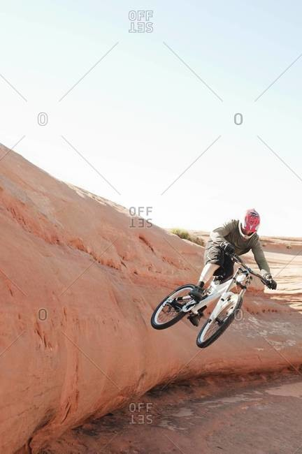 Man doing a stunt on a BMX bicycle