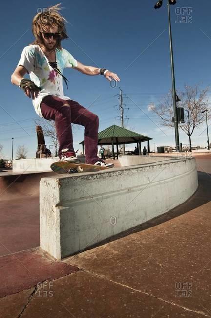 Skateboarder grinding on a ledge