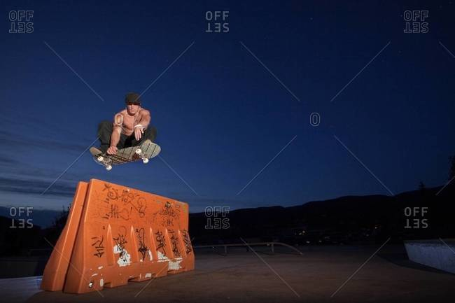 Skateboarder doing a front side grab